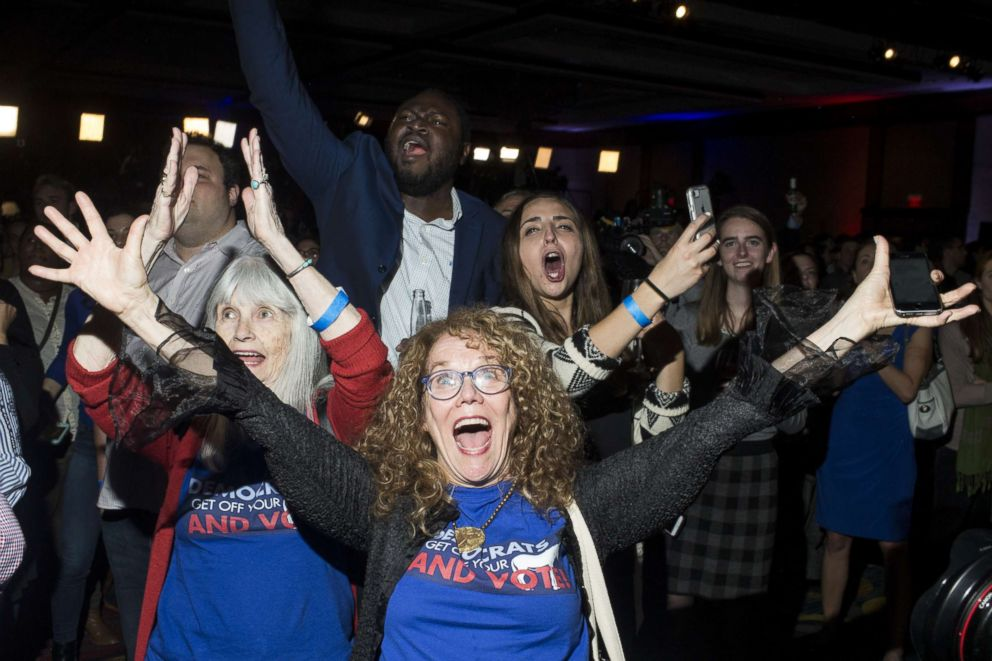 PHOTO: JoAnn Loulan, center, reacts with her mother-in-law, Sydney Crawford, left, after Democrats gained control of the House of Representatives during the 2018 midterm election at a DCCC election watch party, Nov. 6, 2018, in Washington, D.C.