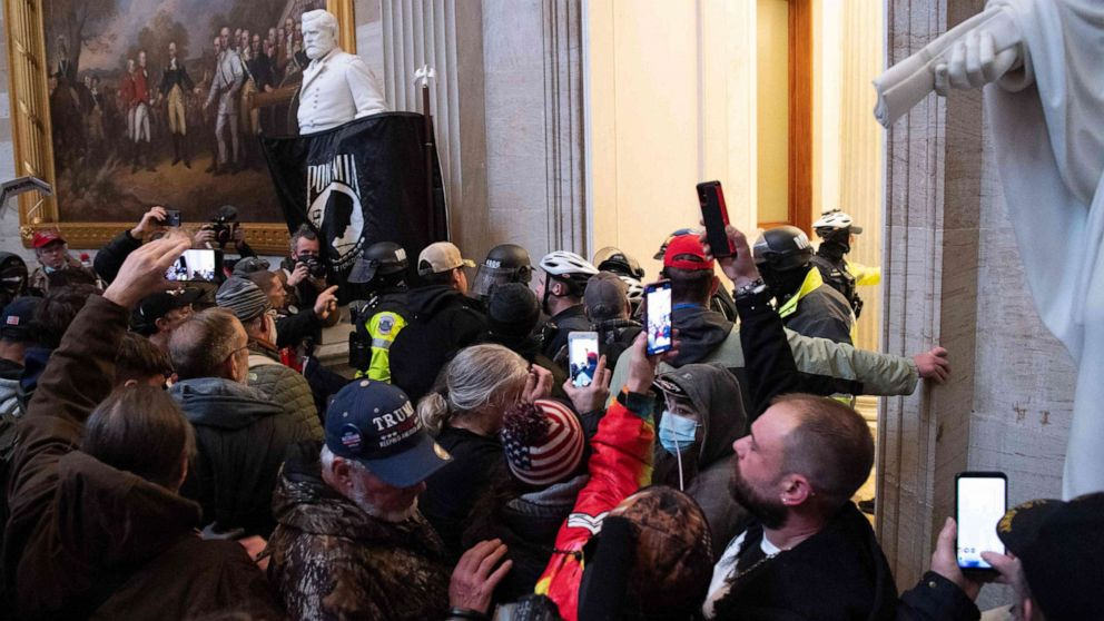 Woman fatally shot after pro-Trump supporters storm the Capitol - cover