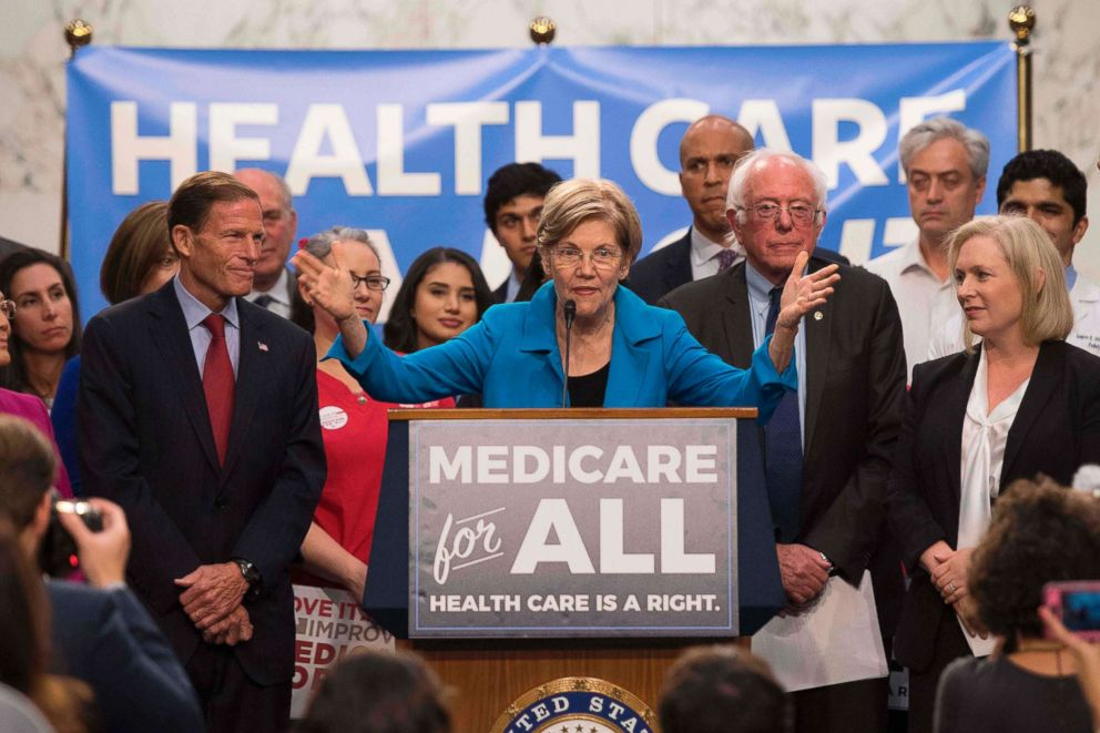 Sen. Elizabeth Warren, center, speaks alongside other members of congress as they discuss Medicare for All legislation on Capitol Hill in Washington, DC.