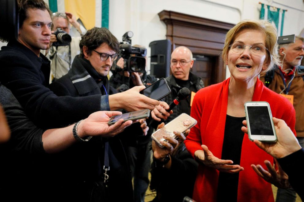 Warren answers questions from reporters after speaking at Plymouth State University in Plymouth N.H. Feb. 23 2019