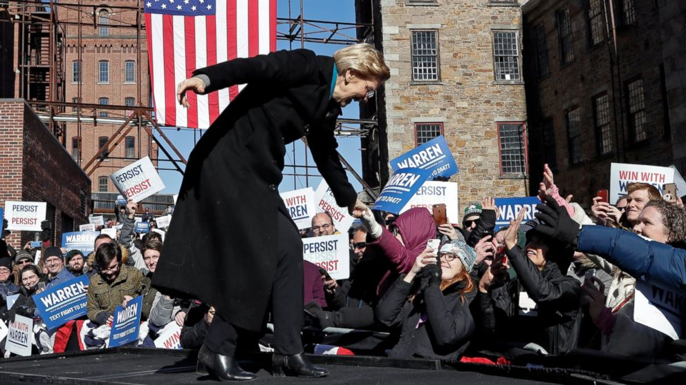 Sen. Elizabeth Warren, D-Mass., shakes hands with supporters as she takes the stage during an event to formally launch her presidential campaign, Saturday, Feb. 9, 2019, in Lawrence, Mass.