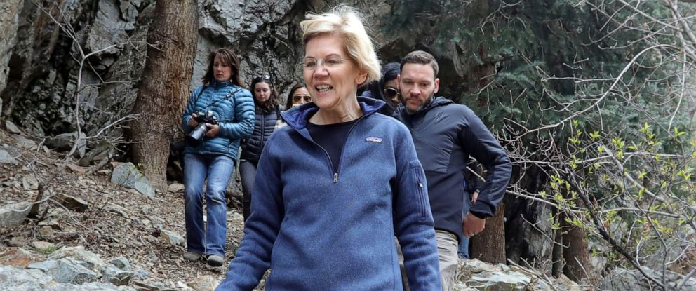 PHOTO: Democratic presidential candidate Sen. Elizabeth Warren, D-Mass., walks with Carl Fisher, of Save Our Canyons, during an visit to Big Cottonwood Canyon Wednesday, April 17, 2019, east of Salt Lake City.