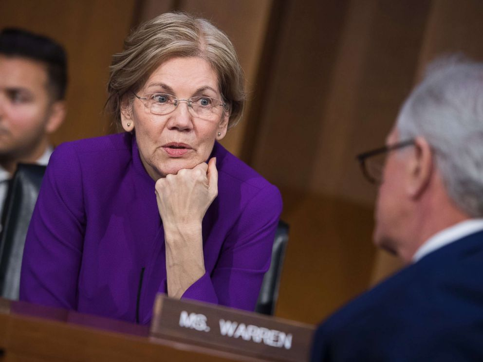 PHOTO: Sen. Elizabeth Warren talks with Sen. Bob Corker during a Senate Armed Services Committee hearing on nominations in the Hart Building, Feb. 8, 2018, in Washington.