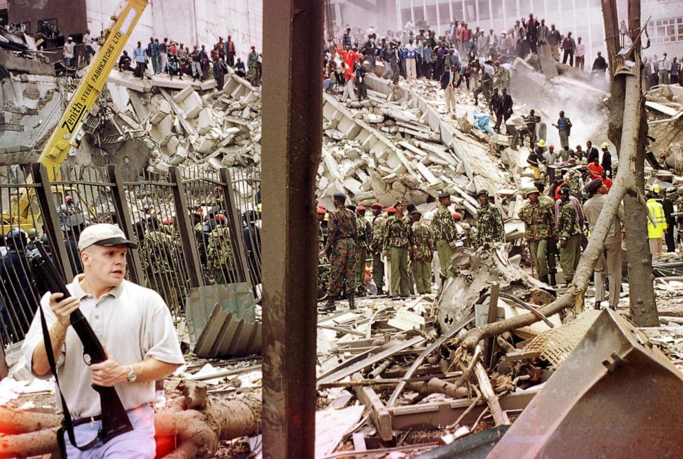 PHOTO: Rescuers work to help survivors amid the devastation brought in by a bomb explosion near the US embassy and a bank in Nairobi August 7, 1998, that killed at least 60 people, including eight Americans, and left more than 1,000 injured.