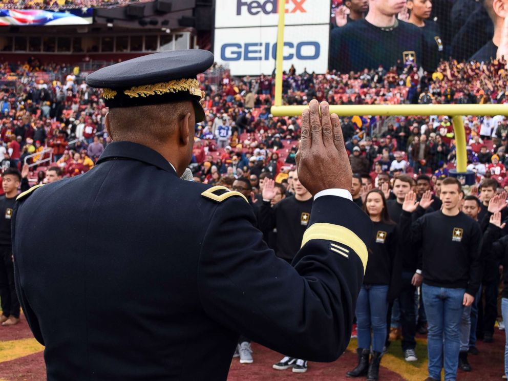 PHOTO: Brig. Gen. Kevin Vereen gives the Oath of Enlistment to nearly 100 people during halftime at a Redskins game at FedEx Field, Nov. 12, 2017.