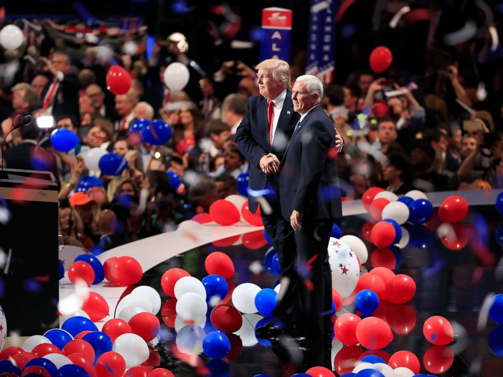 PHOTO: Republican presidential nominee Donald Trump and running mate Mike Pence stand on the stage together as balloons drop on the final day of the 2016 Republican National Convention in Cleveland, July 21, 2016.