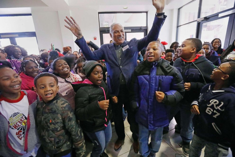Students from the Barack H. Obama Magnet Elementary School in Jackson, Miss., shout their support with candidate Mike Espy, center, at the Millsaps College Student Union in Jackson, Miss., Nov. 15, 2018.