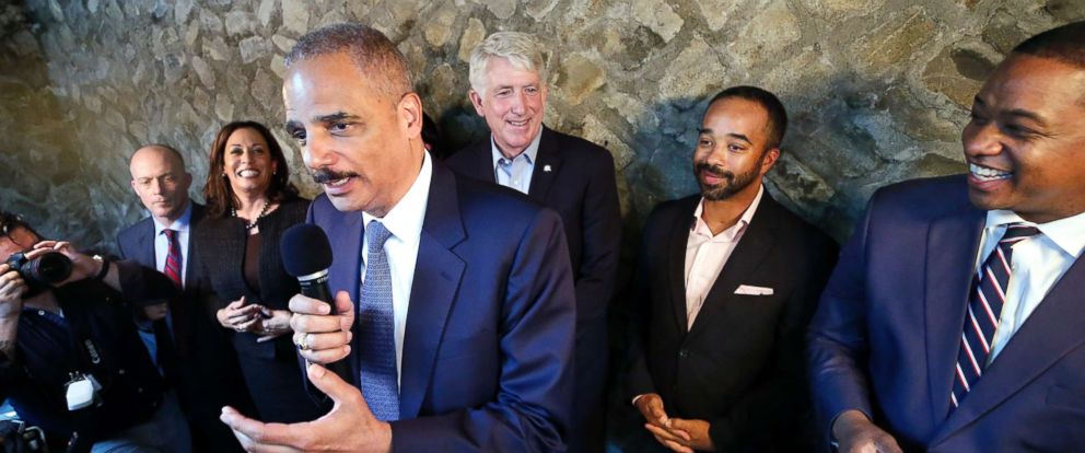 Former Attorney General Eric Holder, center, speaks during a get-out-the-vote event at Blue Bee Cider in Richmond, Va., Oct. 29, 2017. He told Stephen Colbert on Monday hes considering a president run.