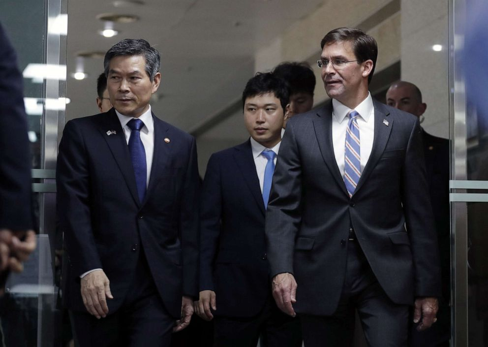 PHOTO: US Secretary of Defense Mark Esper and South Korean Defense Minister Jeong Kyeong-doo arrive for a signing ceremony ahead of a meeting at the Defense Ministry in Seoul, South Korea, August 9, 2019.