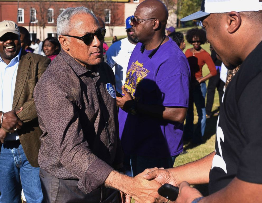 PHOTO: Mike Espy, who is seeking to unseat appointed Sen. Cindy Hyde-Smith, R-Miss., shakes hands with a supporter during a rally in Vicksburg, Miss., Nov. 16, 2018.