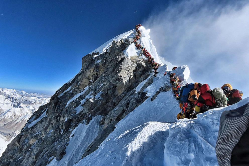 PHOTO: This handout photo taken on May 22, 2019 and released by climber Nirmal Purjas Project Possible expedition shows heavy traffic of mountain climbers lining up to stand at the summit of Mount Everest.