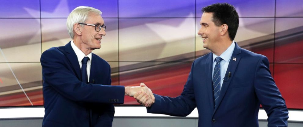 PHOTO: Democratic challenger Tony Evers, left, and Wisconsin Gov. Scott Walker shake hands during gubernatorial debate in Madison, Wis., Oct. 19, 2018.