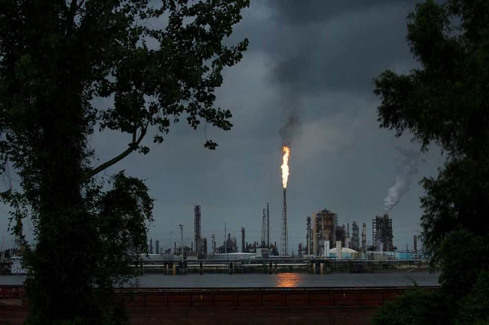 PHOTO: A gas flare from the Shell Chemical refinery is shown on August 21, 2019 in Norco, LA. The plant agreed to install $10 million in pollution monitoring and control equipment in 2018 to settle allegations flares were in violation of federal law.