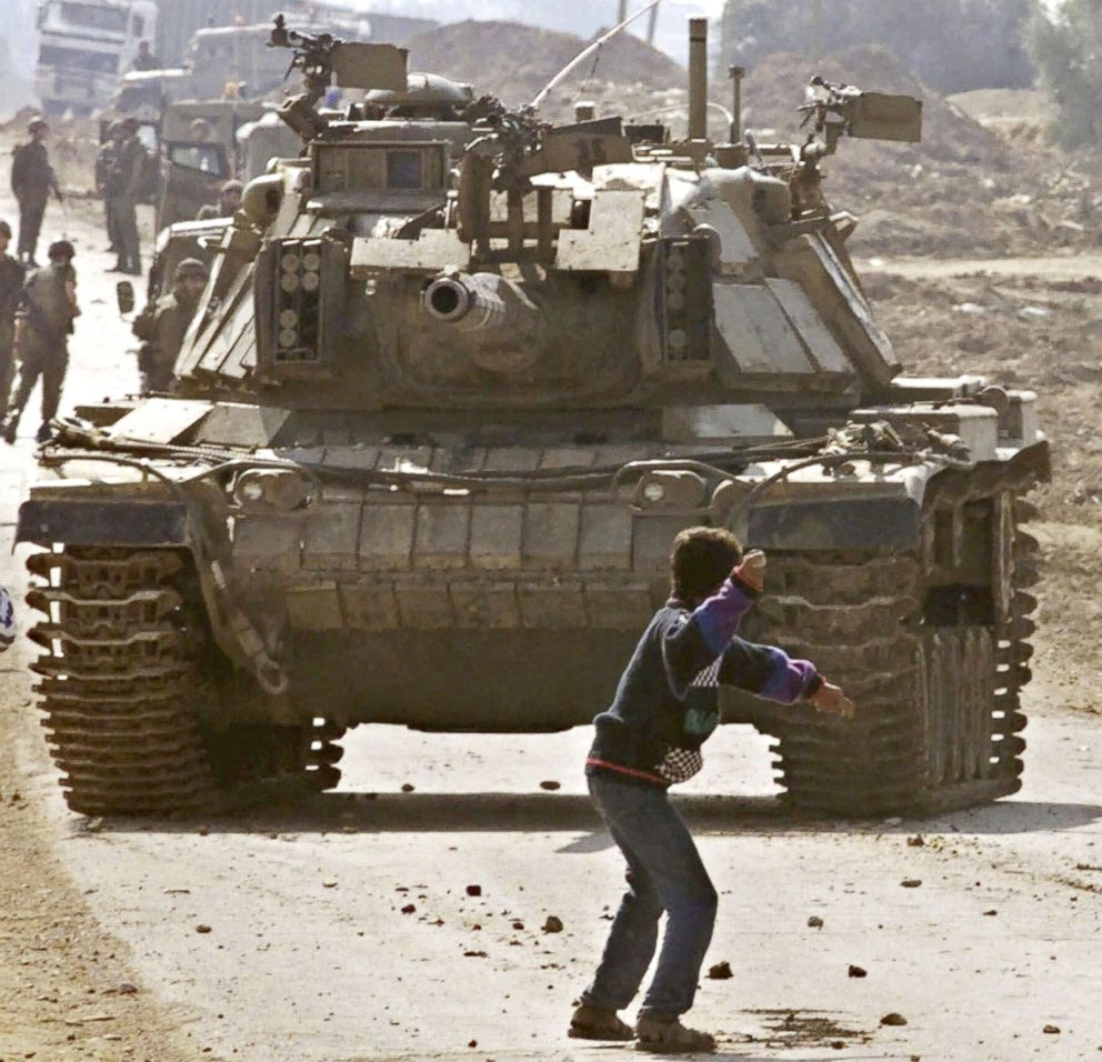 PHOTO: A Palestinian stone thrower faces an Israeli tank, during clashes at the Karni crossing point between Israel and the Gaza Strip, on the outskirts of Gaza City, in this Oct. 29, 2000 file photo.