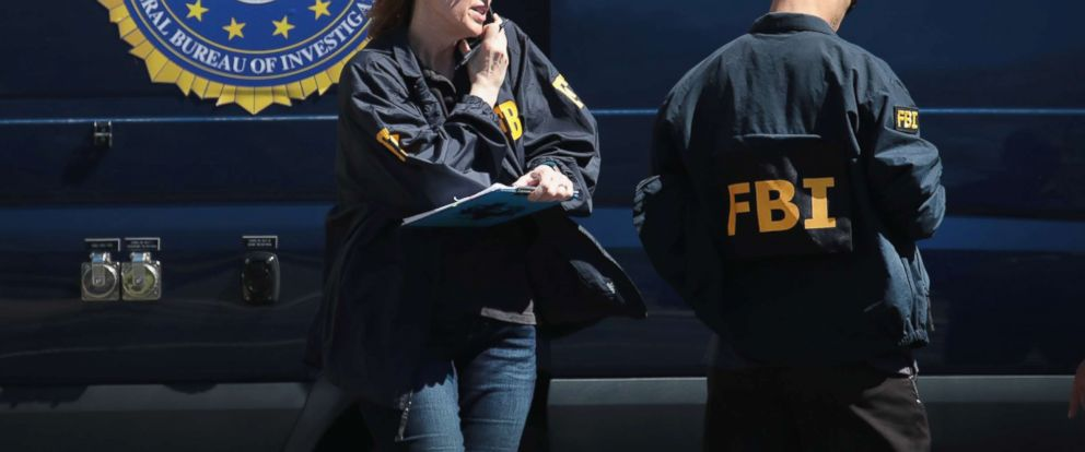 PHOTO: FBI agents collect evidence, March 20, 2018, in Sunset Valley, Texas.