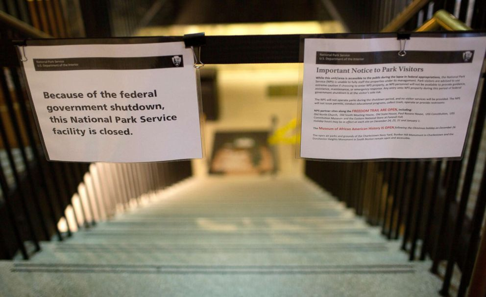 A sign announces the closure of the U.S. Parks Department Information Booth and Visitor Center because of the federal government shutdown, at Faneuil Hall in Boston, Dec. 24, 2018.