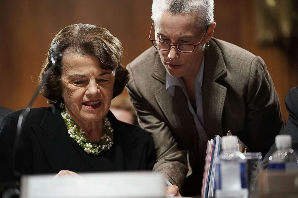 PHOTO: Sen. Dianne Feinstein listens to an aide during a markup hearing before the Senate Judiciary Committee, Sept. 13, 2018, on Capitol Hill.