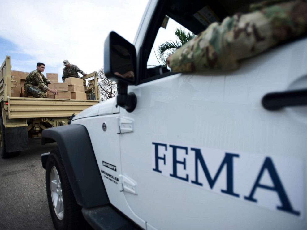 PHOTO: In this Oct. 5, 2017 file photo, Department of Homeland Security personnel deliver supplies to Santa Ana community residents in the aftermath of Hurricane Maria in Guayama, Puerto Rico.