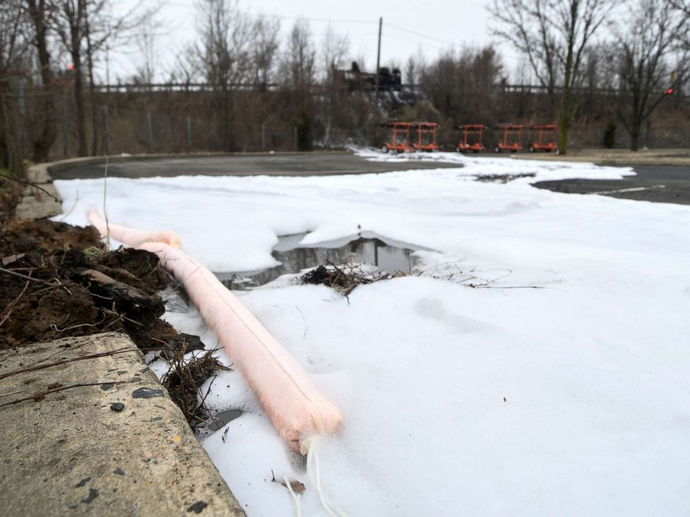 PHOTO: Absorbent booms are used to contain aqueous film forming foams (AFFF) from spilling into the surface water near a scene of a Class B fire of a tanker truck at an off ramp of the Interstate I-95, in Bensalem Township, Penn., Feb. 7, 2019.