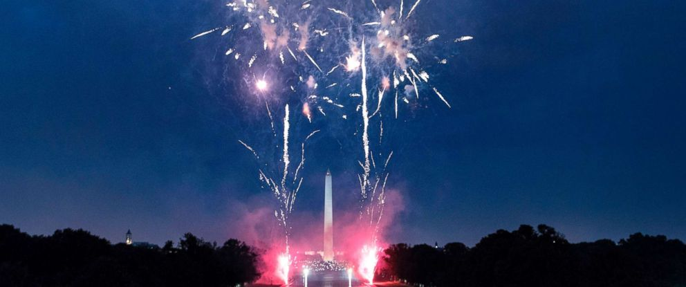 PHOTO: People watch fireworks as they celebrate US independence day on July 4, 2017, in Washington, DC.