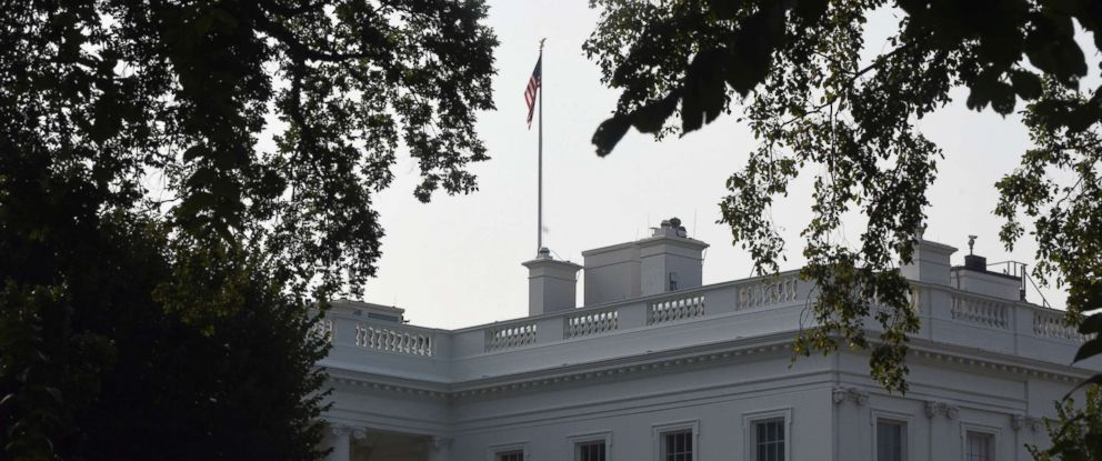 PHOTO: The White House flag is raised back to full-staff Aug. 27, 2018 after only one day half-staff in honor of the late Sen. John McCain in Washington, DC.