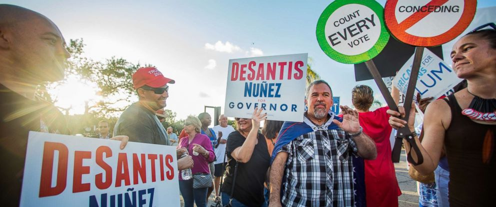 PHOTO: Supporters of Ron DeSantis and Rick Scott protest the handling of election results while clashing with Andrew Gillum supporters outside of the Broward County Supervisor of Elections Office in Lauderdhill, Fla., Nov. 9, 2018.