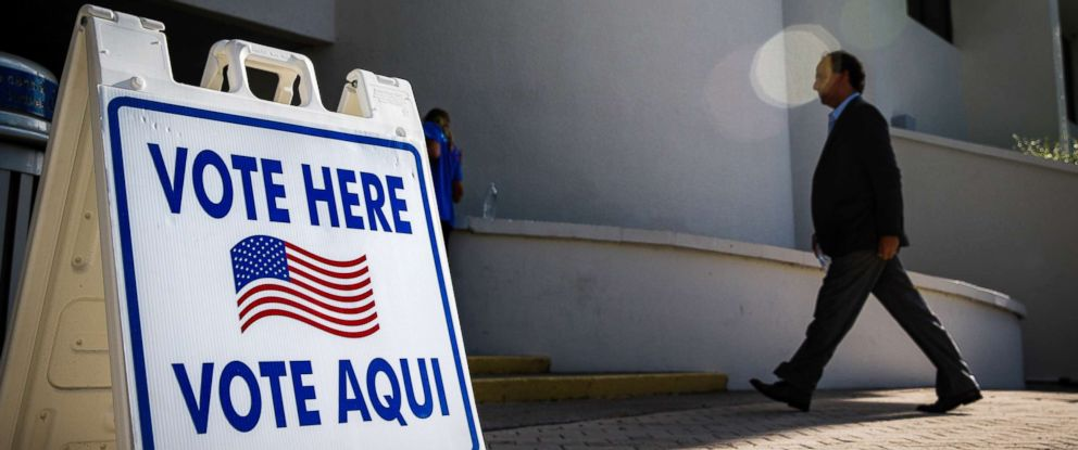 PHOTO: A voter enters a polling location in Miami Beach, Florida, Aug. 28, 2018.