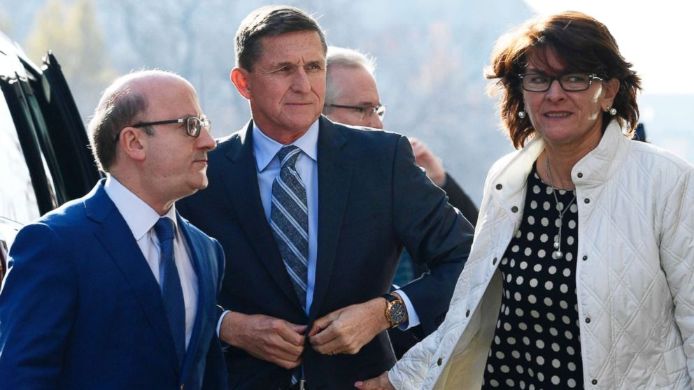 Former Trump national security adviser Michael Flynn, center, arrives at federal court in Washington, Friday, Dec. 1, 2017. At left is his attorney,Robert Kelner. Flynn's wife, Lori Andrade, is at right.