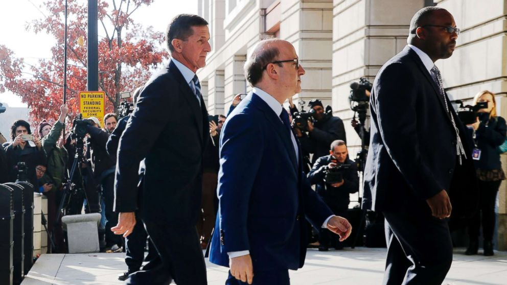 Former U.S. National Security Adviser Michael Flynn, left, with his attorney Robert Kelner, center, as he arrives for a plea hearing at U.S. District Court in Washington,D.C., Dec. 1, 2017.