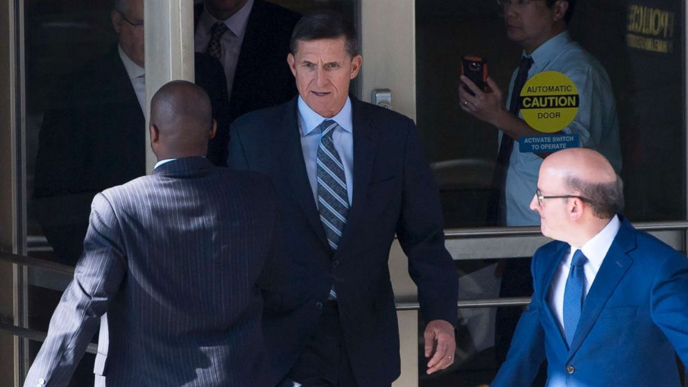 Gen. Michael Flynn, center, with his attorney, Robert Kelner, right, leaves Federal Court in Washington, DC, December 1, 2017 after pleading guilty to one count of lying to the FBI about his back-channel negotiations with the Russian ambassador.