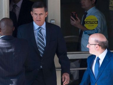 PHOTO: Gen. Michael Flynn, center, with his attorney, Robert Kelner, right, leaves Federal Court in Washington, DC, December 1, 2017 after pleading guilty to one count of lying to the FBI about his back-channel negotiations with the Russian ambassador.