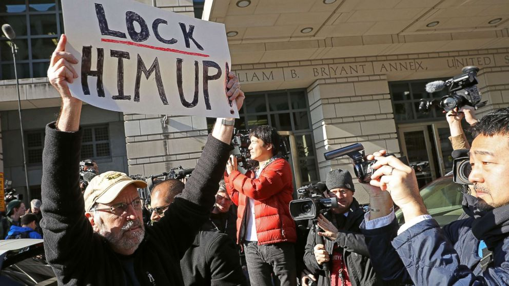 A handful of demonstrators held signs outside the Federal Courthouse where Michael Flynn, former national security adviser to President Donald Trump, had his plea hearing December 1, 2017 in Washington, DC.