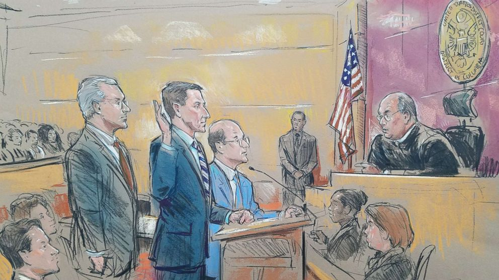 Courtroom sketch showing former National Security Adviser Michael Flynn standing between his two lawyers today as he appeared before Federal Judge Rudolph Contreras during his appearance in court.