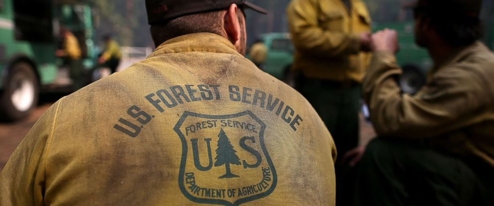 PHOTO: U.S. Forest Service firefighters take a break from battling the Rim Fire at camp Mather near Groveland, Calif., August 25, 2013.