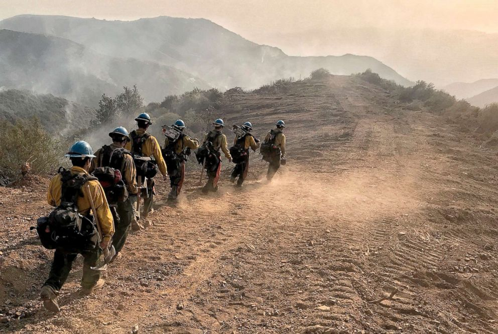 PHOTO:U.S. Forest Service hot shot crew members head down a fire break to work off E. Camino Cielo in Santa Barbara, Calif., Dec. 17, 2017.Thousands of firefighters tried to shield area communities from one of the biggest wildfires in California history.