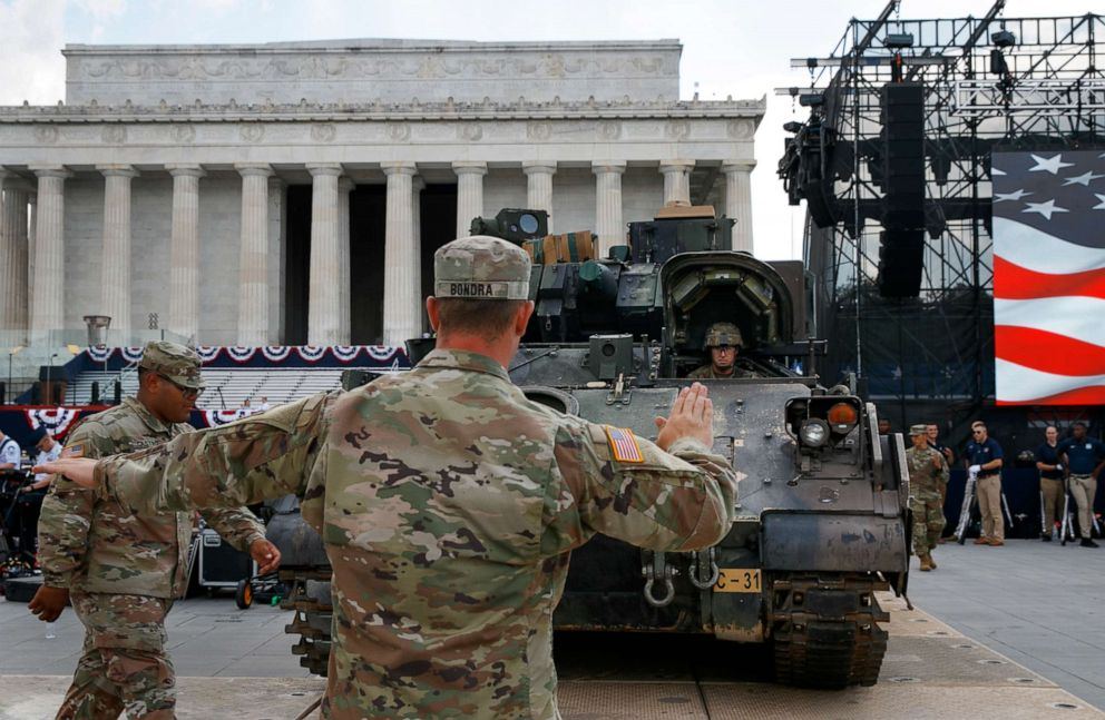 PHOTO: Soldiers with the 3rd Infantry Division, 1st Battalion, 64th Armored Regiment, move a Bradley Fighting Vehicle into place by the Lincoln Memorial, July 3, 2019.