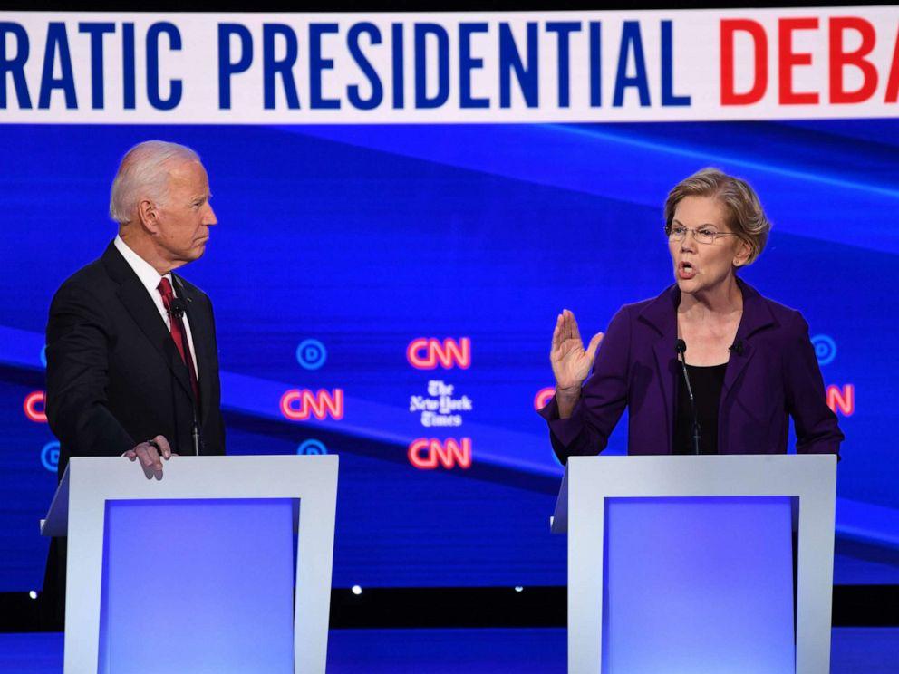 PHOTO: Democratic presidential hopefuls Sen. Elizabeth Warren and former Vice President Joe Biden speak during the fourth Democratic primary debate at Otterbein University in Westerville, Ohio, Oct. 15, 2019.