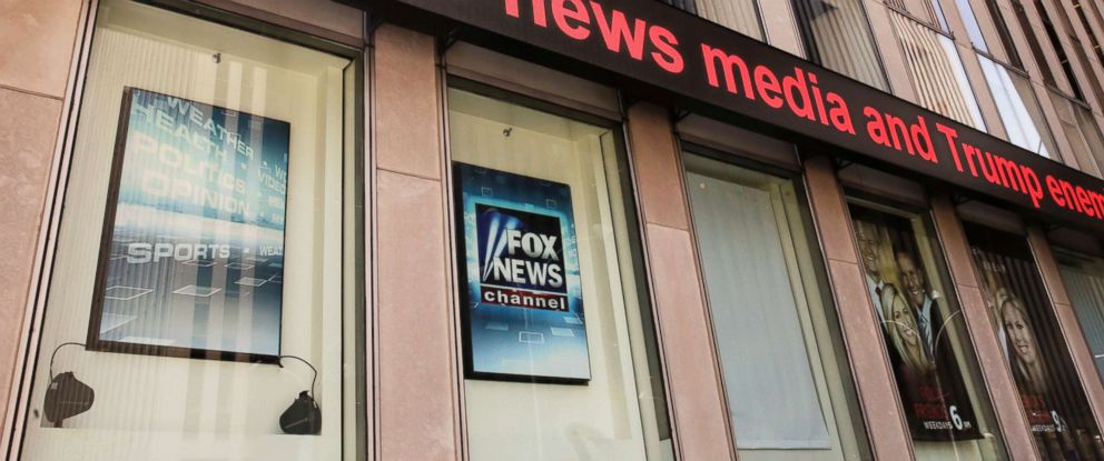 PHOTO: News headlines scroll above the Fox News studios in the News Corporation headquarters building in New York, Aug. 1, 2017.