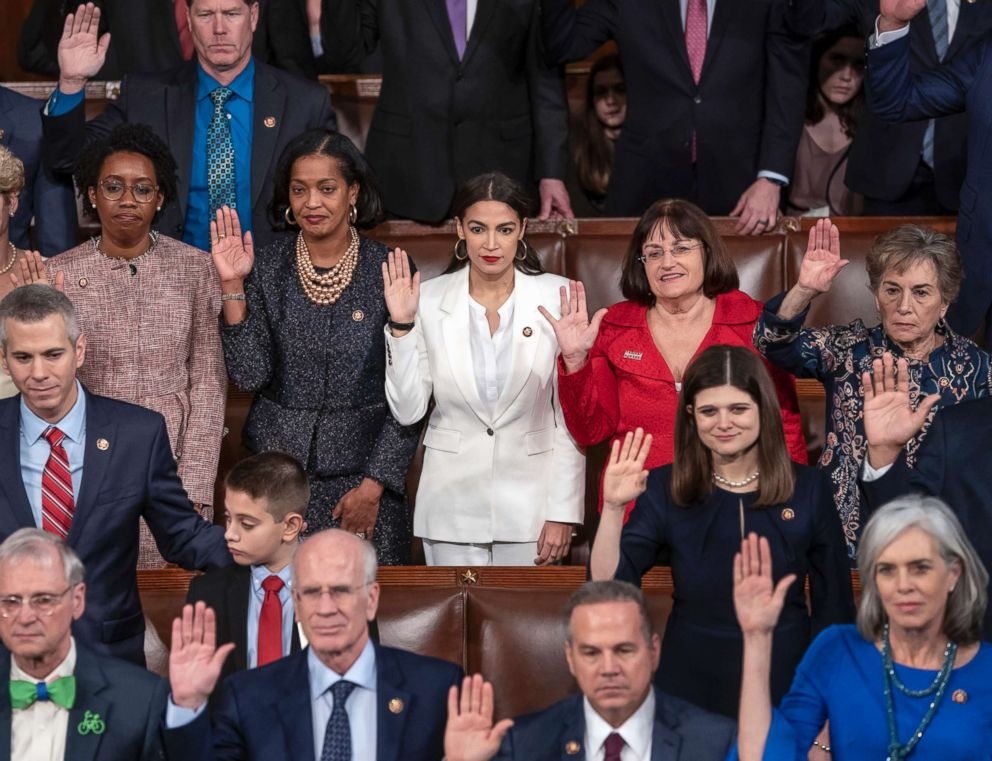PHOTO: Rep. Alexandria Ocasio-Cortez, center, a freshman Democrat from New York, is flanked by Rep. Jahana Hayes, D-Conn., left, and Rep. Ann McLane Kuster, D-N.H., right, as they are sworn in at the U.S. Capitol, Jan. 3, 2019.