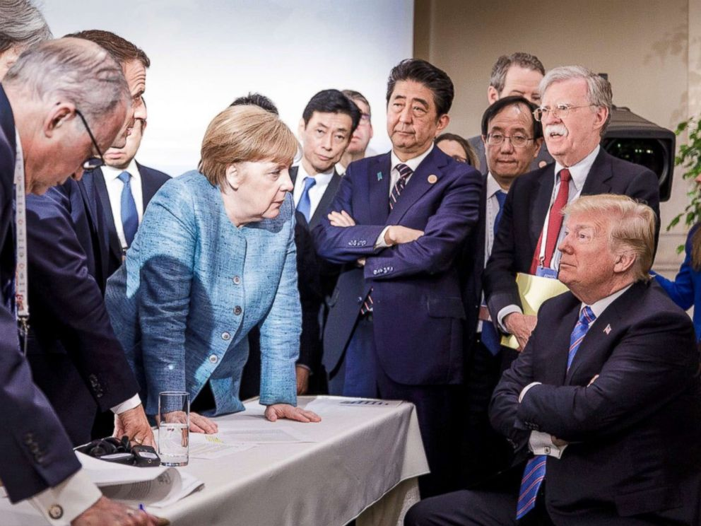 PHOTO: In this photo made available by the German Federal Government, German Chancellor Angela Merkel, center, speaks with U.S. President Donald Trump, seated at right, during the G7 Leaders Summit in La Malbaie, Quebec, Canada, June 9, 2018.