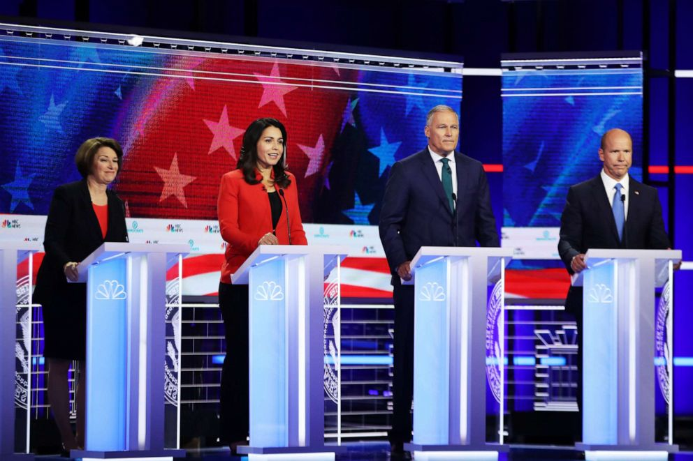 PHOTO: Sen. Amy Klobuchar (D-MN), Rep. Tulsi Gabbard (D-HI), Washington Gov. Jay Inslee and former Maryland congressman John Delaney take part in the first night of the Democratic presidential debate on June 26, 2019 in Miami, Florida.