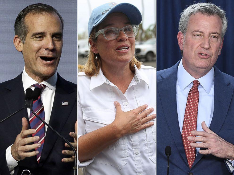 Los Angeles Mayor Eric Garcetti, left, San Juan Mayor Carmen Yulin Cruz and New York Mayor Bill de Blasio.