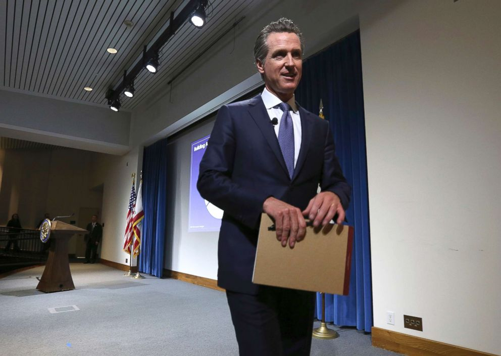 PHOTO: California Gov. Gavin Newsom leaves the auditorium stage after presenting his first state budget during a news conference, Jan. 10, 2019, in Sacramento, Calif.