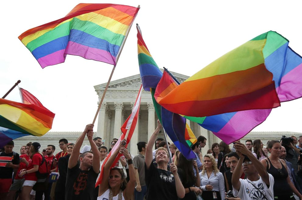 Same-sex marriage supporters rejoice after the U.S Supreme Court handed down a ruling legalizing same-sex marriage, June 26, 2015, outside the Supreme Court in Washington.