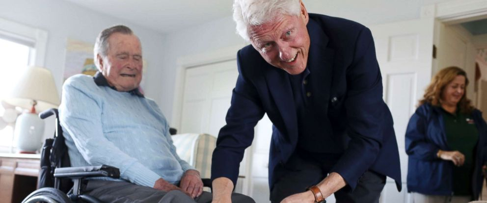 "PHOTO: Former President Bill Clinton jokes with former President George H.W. Bush, as Bush shows off a pair of ""Bill Clinton socks,"" while Clinton visits Bush at his home in Kennebunkport, Maine, June 25, 2018."