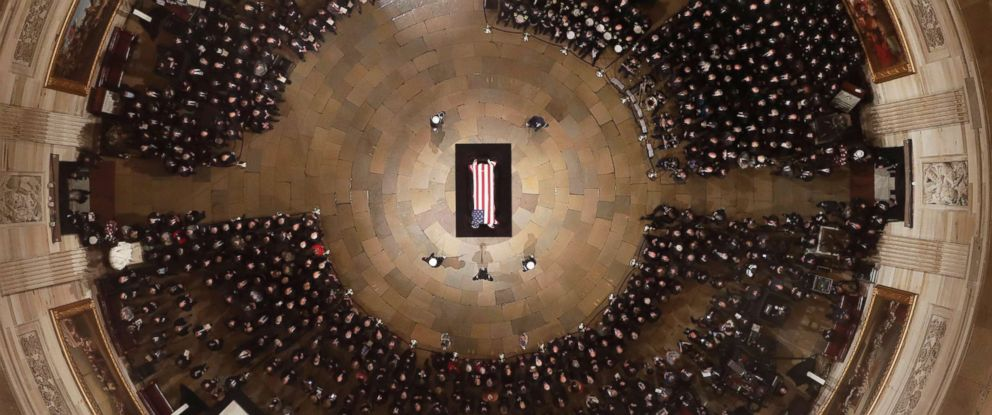 PHOTO: The coffin bearing the remains of former President George H.W. Bush rests atop a catafalque at the Capitol in Washington D.C., Dec. 3, 2018.