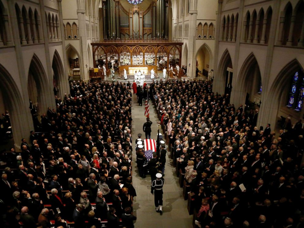 PHOTO: The flag-draped casket of former President George H.W. Bush is carried by a joint services military honor guard into St. Martins Episcopal Church, Dec. 6, 2018, in Houston.