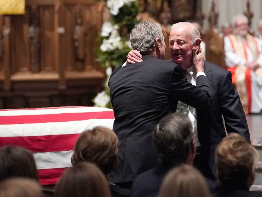 PHOTO: Former President George W. Bush embraces former Secretary of State James Baker, right, after he gave a eulogy during the funeral for former President George H.W. Bush at St. Martins Episcopal Church, Dec. 6, 2018, in Houston.