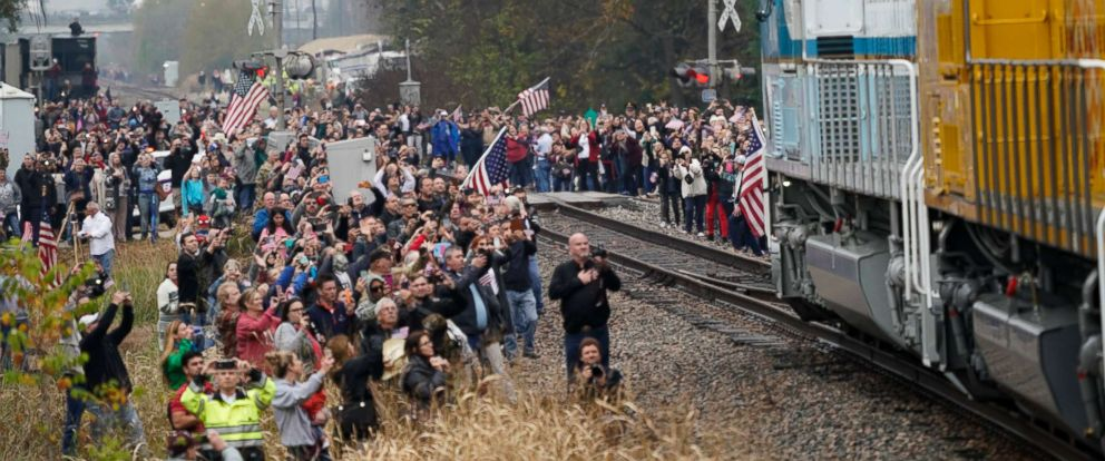 PHOTO: People pay their respects as the train carrying the casket of former President George H.W. Bush passes, Dec. 6, 2018, along the route from Spring to College Station, Texas.