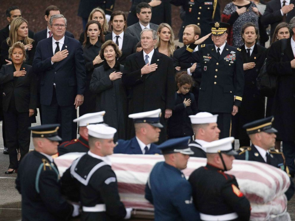 PHOTO: The Bush family looks on as a joint military services honor guard carries the casket for former President George H.W. Bush from the Union Pacific funeral train at Texas A&M University in College Station, Texas, Dec. 6, 2018.